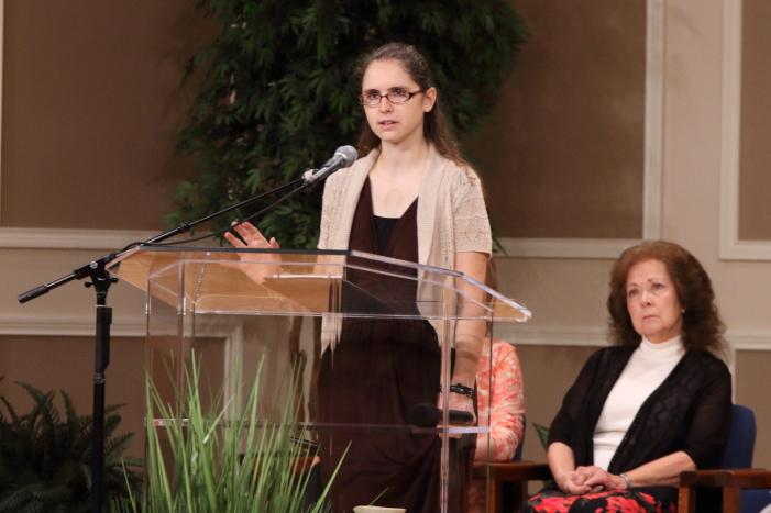 Rita Braeshear listening to Anna Quigley share her testimony.