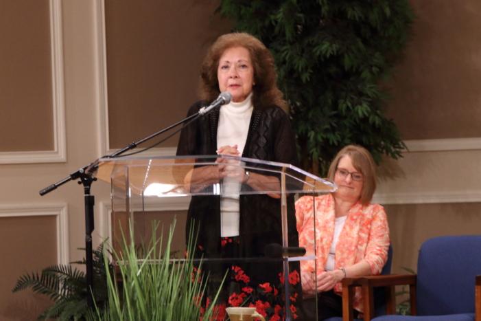 Beth Bartlett listening to Rita Brashear sharing her testimony.