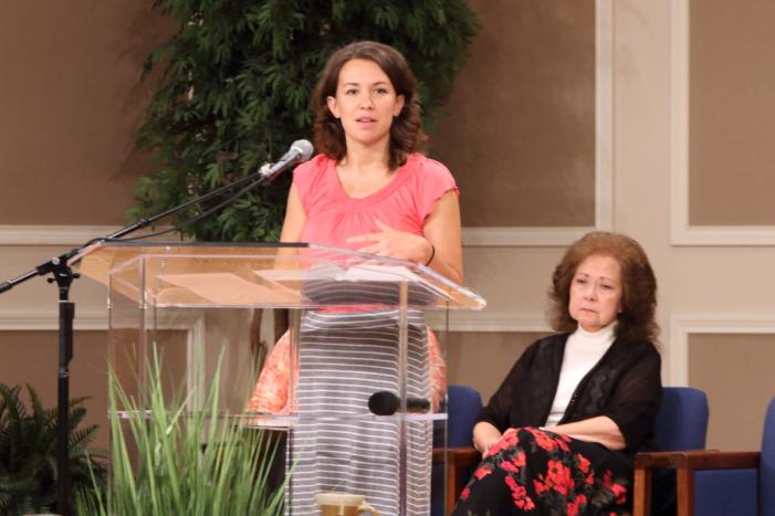 Rita Brashear listening to Sara Reichert sharing her testimony.