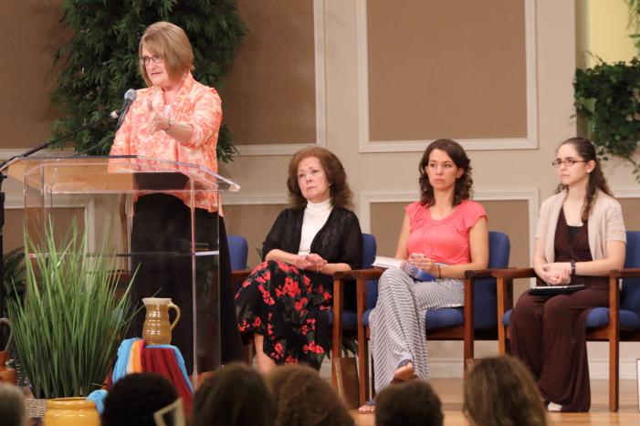 Beth Bartlett shares her testimony while Rita Brashear, Sara Reichert, and Anna Quigley listen.
